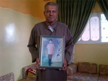 Abu Habel father with pic of his minor son he was denied to visit in prison